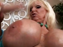 tanned blonde with massive milk sacks engulfing